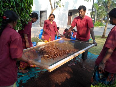 Housekeepers sieving the compost prepared from kitchen waste.