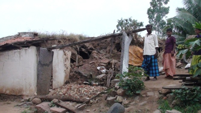Malleshappa Hugar of Hiresindhogi, Koppal district, in front of his collapsed house.