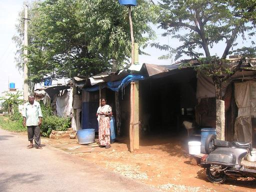 Mallappa and Vijayamma in front of their house located right in front of the landfill.