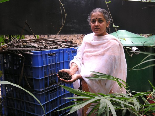 Eco activist Vani Murthy with a handful of compost taken out of a Byobin.