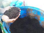 Black, earthy compost.
