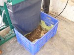 Pulverised waste is collected in a crate.