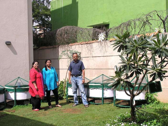 The Prudent Eco Systems Team: (L to R) Vaishali Kerekatte, Latha & Ravindra Karnad. These Marigold composters installed here were from the first batch with a cement container. Now you get steel-bodied Marigold which are more efficient, portable and elegant.