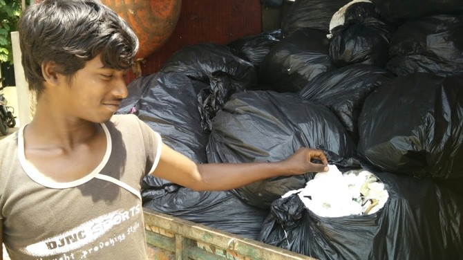 """""""These bags are full of tissue papers,"""" says this ITC employee who picks up the load from various destinations and brings it to the DWCC."""