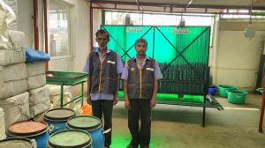Staff members who manage Shudh-Labh digesters to process 150-180 kgs of waste into quality compost.